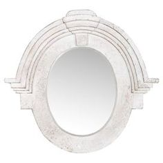 """Hand-carved salvaged wood wall mirror with crown moldings and an antique white finish.  Product: Wall mirrorConstruction Material: Salvaged wood and mirrored glassColor: Antique whiteFeatures: Hand-carvedDimensions: 28"""" H x 30"""" W x 5"""" D"""