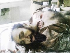 The REAL Osama Bin Laden death photo (the only one I could find as there were many before he was fed to the fish).