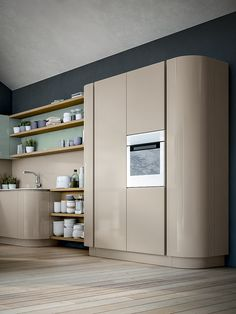 XXL VOL. 3 The tall pantry units echo the soft, corner-free forms of the whole kitchen.