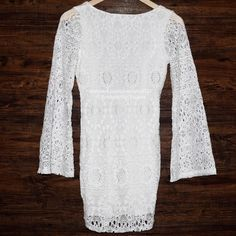 FREE PEOPLE Lace Dress Bodycon Bell Sleeve Eyelet Size Small. New with tags. $352 Retail + Tax.  Stunning white bell sleeve lace dress with deep scoop cutout back.  Basic lining.  Stretchy & comfortable. By Nightcap for Free People.  Polyamide, viscose, elastane. Made in the USA.   ❗️ Please - no trades, PP, holds, or Modeling.    Bundle 2+ items for a 20% discount!    Stop by my closet for even more items from this brand!  ✔️ Items are priced to sell however reasonable offers will be…