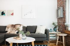 Madelynn Furlong's Minneapolis Apartment Tour #theeverygirl apartment interior, minneapoli, hous, wooden flooring, industrial style, apartments, live room, white wall, table designs