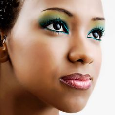 Amazing blended eye shadow with greens, blues and yellows! #WomanCrushWednesday #FloridaAcademy