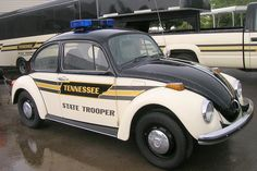 Special: Tennessee State Trooper VW Classic Beetle. Notice the large  truck and trailer behind the VW.