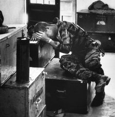 In a supply shack, hands covering his face, an exhausted, worn James Farley gives way to grief