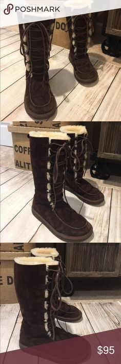 🌸UGG🌸UPTOWN LACE UP Chocolate Brown boot Sz7 🌸UGG🌸 UPTOWN LACE UP Beautiful Tall Chocolate Brown boot Sz 7 truly super comfy for the cooler weather and for those cold feet!  These chocolate brown uggs are super unique...you will get compliments!  In great condition.  There is a spot on the inside right boot it is NOT easily seen, See photo. UGG Shoes Lace Up Boots