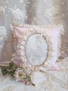 Nice lace-trimmed pillow. Center medallion could be a beautiful embroidery...