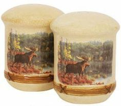 """MOOSE wildlife SALT and PEPPER SHAKERS Kitchen Decor by Blonder. $19.99. Made of quality earthenware.. Measures 6.89"""" wide and 4.33"""" high.. The generous size and gorgeous colors are sure to make this set a favorite on your table all year round. This stunning wilderness scene is captured in remarkable detail by renowned nature artists, The Hautman Brothers. An artful and functional addition to your wildlife themed decor. Made of quality earthenware. Measures 6.89"""" w..."""