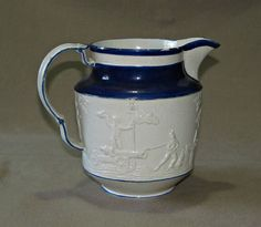 A rare 'Castleford' commemorative stoneware jug, Wellington / Peninsula War 17cm high / 19cm max width.  The jug is in good original condition with no restoration. There is a firing crack to the top terminal of the handle and by this a light hairline on the handle £125