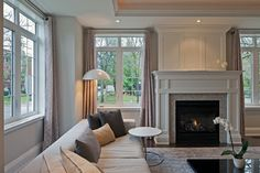 Light Grey stone pencil tile fireplace surround in beautiful transitional living room.