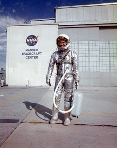 Rare Snapshots From the Space Race | Mental Floss  Cooper with his suit ventilator in front of Hangar S at Cape Canaveral. His Mark IV Goodrich suit incorporated many changes from Shepard's suit, including boots, improved gloves, and new shoulder construction.