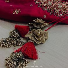"""Nothing attracts attention like a red dress. Saree Tassels Designs, Saree Kuchu Designs, Saree Blouse Neck Designs, Fancy Blouse Designs, Bridal Mehndi Dresses, Saree Jewellery, Hand Embroidery Dress, Stylish Blouse Design, Fabric Jewelry"