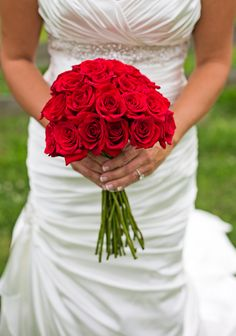 Red, white and blue inspired wedding. :: Red rose bridal bouquet.