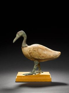 An Egyptian wood and bronze goose. Late Period, circa 664-32 B.C.