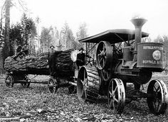 A steam tractor hauling a log back in the day in Raymond Washington
