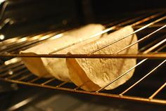 Drape tortillas on your oven rack and bake @ 300 degrees. Healthier than frying.