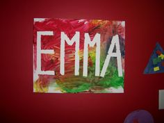 Tape your child's name onto a canvas and let them finger paint around it...Then remove the tape : )
