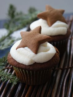 Double Gingerbread Cupcakes Recipe.  Love the gingerbread cookie star cut-out on top.  Top with cream cheese frosting or a basic vanilla or lemon buttercream.