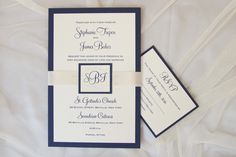 simple and elegant navy invitation with ivory ribbon and monogram tag.