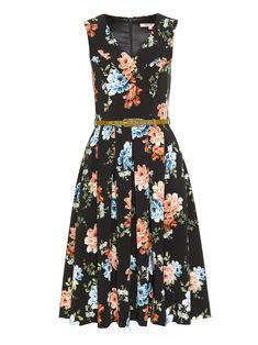 Your new favourite prom dress is here in a beautiful peach and blue floral print! Our flawless Night Blossom dress is the perfect midi length and a great statement dress for lunch with the girls, weekend adventures and more. Crafted in a high quality crepe fabric, the silhouette flatters the body beautifully with a V-neckline, faux wrap collar and tailoredgrosgrain Pear Greenbelt to cinch in the waist. Yes, this dress even has convenient side pockets!