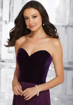 A Beautifully Fitted Strech Velvet Bodice and Flowy Chiffon Skirt Perfectly Compliment Each Other on This Full Length Bridesmaids Dress. View Velvet Swatch Card for Color Options. Shown in Eggplant