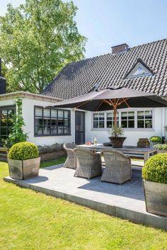 Une maison grise en Belgique