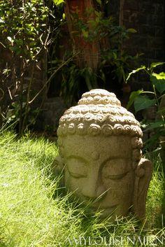 A stone Buddha head sculpture found in the gardens of some art studio's in Vietnam.