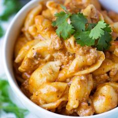 Instant Pot Cheesy Taco Pasta has only 6 ingredients, cooks in under 30 minutes, and is delicious! simplyhappyfoodie.com #instantpotrecipes #instantpotpasta