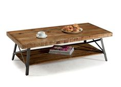 Transform your living space with this reclaimed wood rectangle coffee table. This stunning rustic table has a thick slab of wood that creates the table top and stretcher storage display shelf below. A