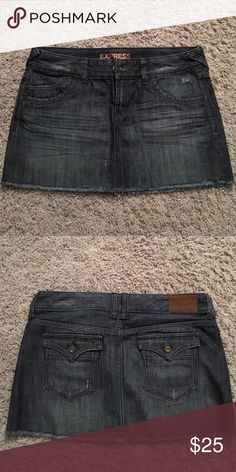 Dark Denim Mini Skirt Dark Jean Mini skirt measuring 11.5 inches in length. Slight whiskering on the front. 2 front & back pockets. Hardly worn in perfect condition. Express Skirts Mini