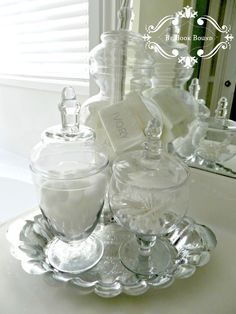 I added apothecary jars on silver trays for a little sparkle .
