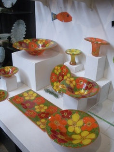 Higgins glass at their open house. Beautiful vintage handmade glass art. Very modern. This is a nice mod plate set that's orange and the plates and bowls look great, there's even a matching christmas fish ornament