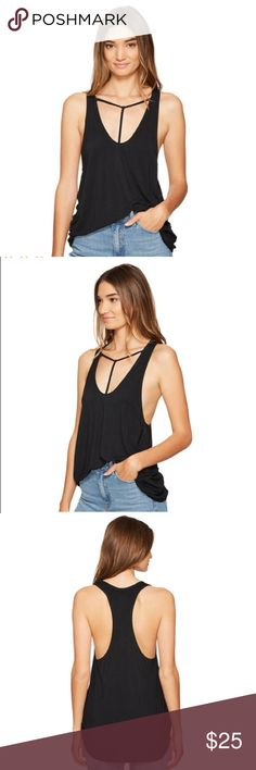 """FREE PEOPLE ~ """"Amelia"""" black strappy tank top FREE PEOPLE ~   Free people brand  """"Amelia""""  Black color  Black tank top  Women's tank top  Strappy front tank top  Low cut tank top  Made in China  Distressed look  Rayon spandex bland  Size medium or small  Ob590450  Flat measurements for small: Bust 16"""" Length 26""""  Flat measurements for medium:  Bust 17"""" Length 28"""" Free People Tops Tank Tops"""