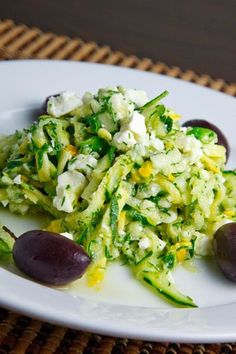 Greek Style Zucchini Salad:1/2 pound zucchini (grated). 1 tablespoon mint (chopped), 1 tablespoon dill (chopped), 1 green onion (sliced), 1/4 cup feta (crumbled), 1/2 lemon (juice and zest), 1 tablespoon olive oil, 1 clove garlic (grated), salt and pepper to taste,