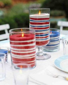 Red, white, and blue bands of sand dress up votive candles to make flickering lights that are cheerful and fun.