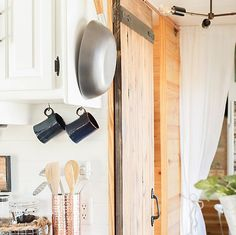 Thinking about updating the kitchen in your camper? Come see how we made a huge impact in our motorhome with our RV kitchen renovation! Barn Door Designs, Rv Interior, Campervan Interior, Sliding Barn Door Hardware, Barn Doors, Barnwood Doors, Sliding Doors, Camper Renovation, Remodeled Campers