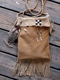Primitive Mountain Man or Native American Style Smoked Deerskin, decorated with coyote fur dangle, wampum bead decorations. by misstudy, $82.00
