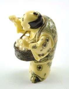"Vintage Man holding Eggs in a basket with handcrafted detail -approx. 3.2"" tall  -material: Resin, with handcrafted detail on whole body -color: Cream color with antique finished look"