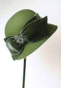 A green wool cloche with wide velvet bow.  From the Victorian Trading Co.