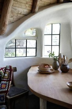 Inside a #PassiveSolar natural home in Denmark, made from cob and a thatch roof. Simple details. Hand built. Beautiful home. More photos and a little explanation here: www.kmldesign.wordpress.com/2014/09/03/a-sustainable-house-made-of-clay/