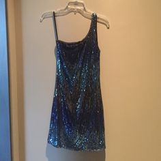 🎉Holiday Party dress🎉Sequin aqua colored NWOT Beautiful and sexy aqua colored sequin mini dress with a black background gorgeous beading! Perfect party dress for the holidays  Never worn, the tag says medium but it runs more like a small and the fit is bodycon. So pretty in person the pictures don't do justice to this beautiful dress!💃 Josh & Jazz Dresses Prom