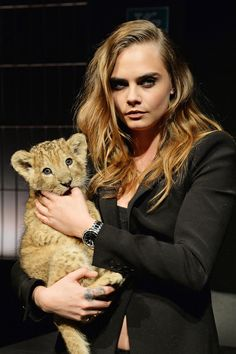 Cara Delevingne for Tag Heuer | Cara Poses with baby lion | Harper's Bazaar