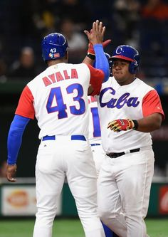 TOKYO, JAPAN - MARCH 10: Outfielder Alfredo Despaigne #54 of Cuba celebrates with his team mates after hitting a grand slam to make it 1-4 in the bottom of the fifth inning during the World Baseball Classic Pool B Game Five between Australia and Cuba at the Tokyo Dome on March 10, 2017 in Tokyo, Japan. (Photo by Matt Roberts/Getty Images)