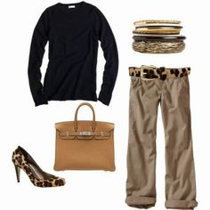 Black sweater leopard skin printed shoes with belt and cream hand bag