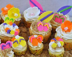 Enjoy Birthday party at - Fun in th sun ideas including ideas like invitation cards, party decorations, games and activities, beach party food and snacks and many other great ideas for a beach birthday party Hawaiian Cupcakes, Beach Theme Cupcakes, Beach Cupcakes, Kid Cupcakes, Themed Cupcakes, Cupcake Party, Cupcake Cakes, Decorated Cupcakes, Theme Cakes