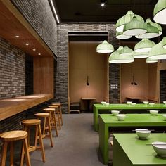 The contrast of the green tables and the green lamps in this Mr. Lee Noodle House by Golucci International Design is the perfect way to make a statement by using a color with high impact against a neutral space. . . . . #interiorcravings #interiordesign #inspiration #decor #designblog #interiordesignblog #designlover #designyourlife #interiorinspo #designblogger #design #interiordesigner #instadecor #style #interiors #decoration #decorlovers #interiordecorating #restaurantdesign...