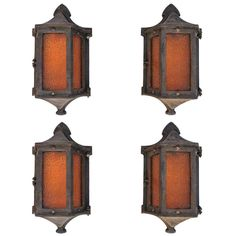 Rare  Set of seven Cast Iron, 1920s Outdoor Sconces ( two are sold )   From a unique collection of antique and modern wall lights and sconces at https://www.1stdibs.com/furniture/lighting/sconces-wall-lights/