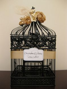 Releasing two doves at the wedding would be cool.  Black Birdcage Wedding Card Holder with by SouthburyTreasures.