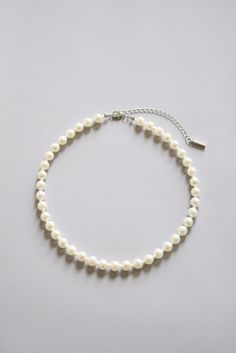 A delicate pearl choker necklace adds a feminine touch to any style. White pearl necklace. Free shipping