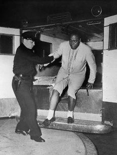 Jazz musician Charlie Parker being taken to Bellevue, Manhattan's leading psychiatric institution