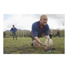 Customizable #20#24#Years #25#29#Years #Adults#Only #Aspirations #Caucasian#Ethnicity #Color#Image #Concentration #Day #Dirty #Full#Length #Horizontal #Kneeling #Only#Men #Outdoors #Photography #Playing #Positioning #Rugby #Rugby#Ball #Sport #Sports #Standing #Two#People #Young#Men Rugby player positioning ball on rugby pitch canvas print available WorldWide on http://bit.ly/2hLVHK1